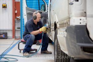 van repair in action by mechanic