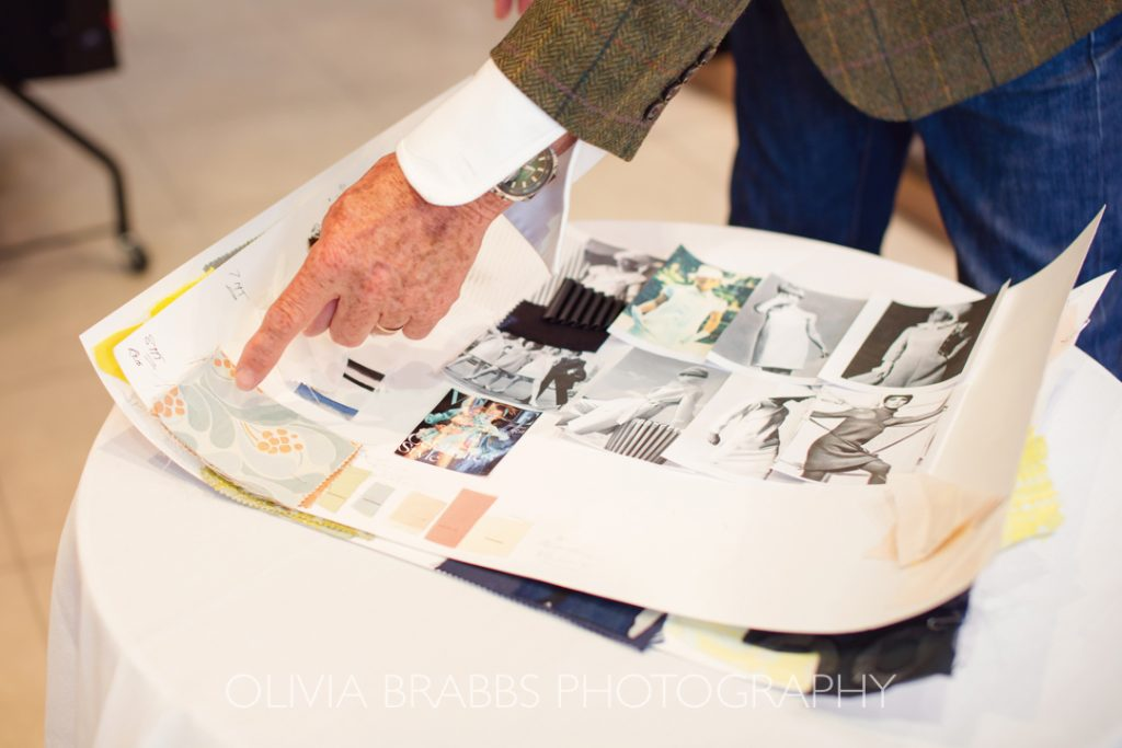 paul costelloe fashion designer pointing to details on collection vision board