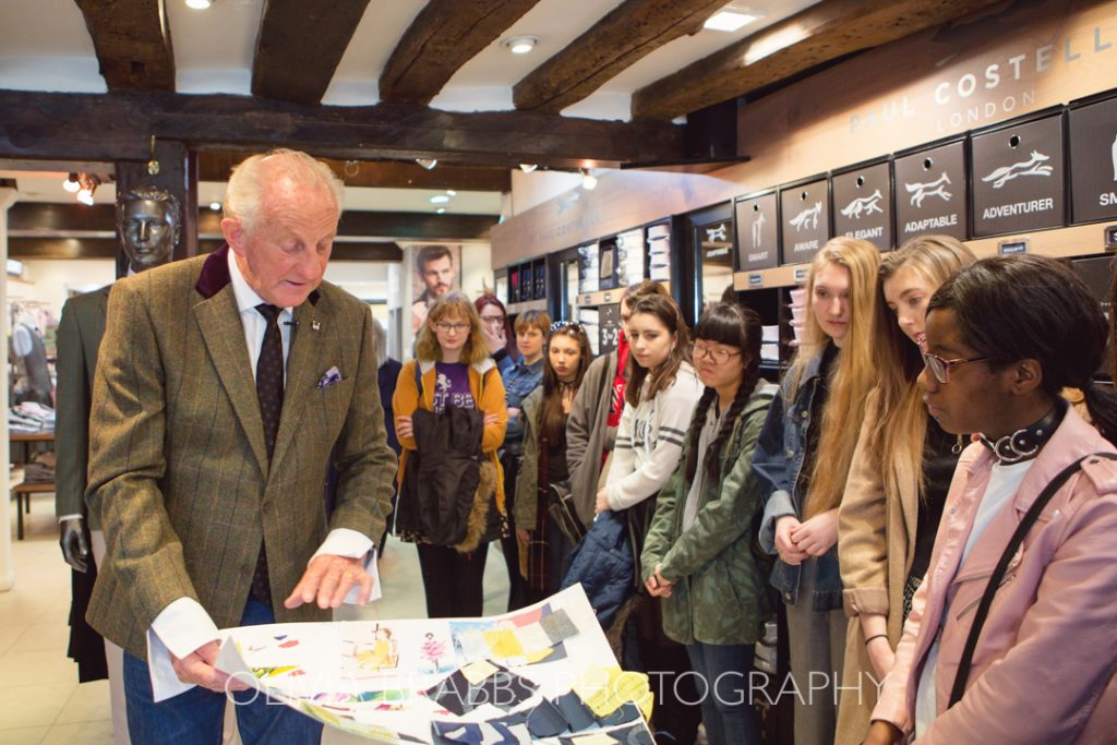 fashion designer paul costelloe showing collection vision board to fashion students