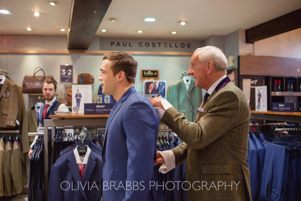 paul costelloe fitting a tailored suit during york fashion week