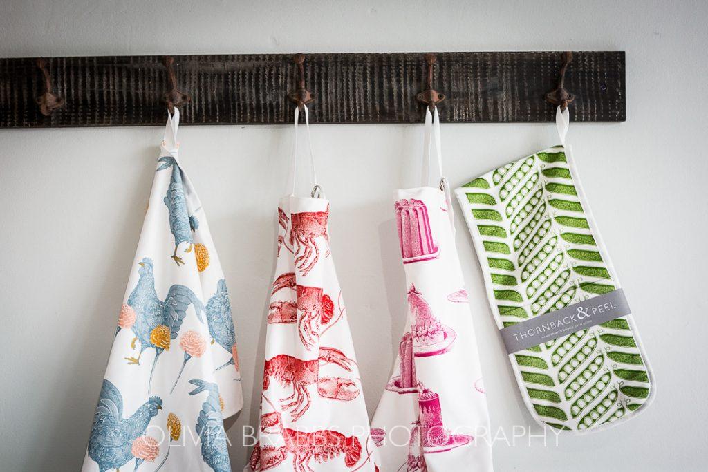 thornback and peel tea towels hanging on display at kemps general store malton