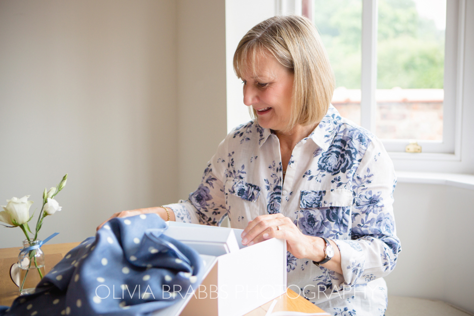 branding photography showing luxury gift boxes being packed by ginny and joy