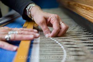 detail image of hands weaving