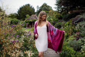 model portrait showcasing meiji designs silk scarf shot in gardens at Grays Court York