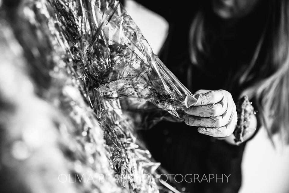 black and white photograph of textile designer at work