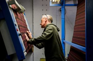 documentary photograph of textile mill worker by yorkshire photographer olivia brabbs