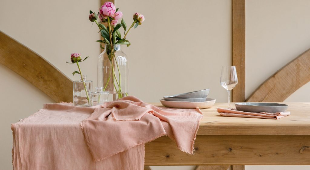 styled lifestyle photography of wooden table with linen, flowers and crockery photographed by olivia brabbs