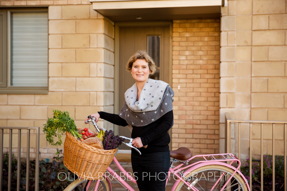 york nutritionist with bicycle and vegetables showcasing a healthy lifestyle