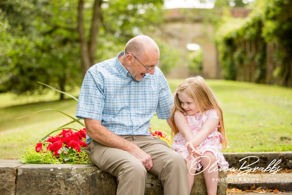 lifestyle image of grandfather and granddaughter in park