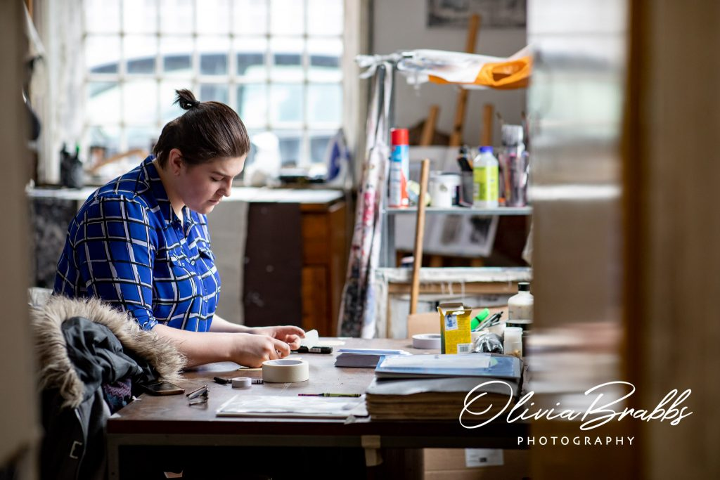 view of artist rhiannon kendall at work in water house studios york