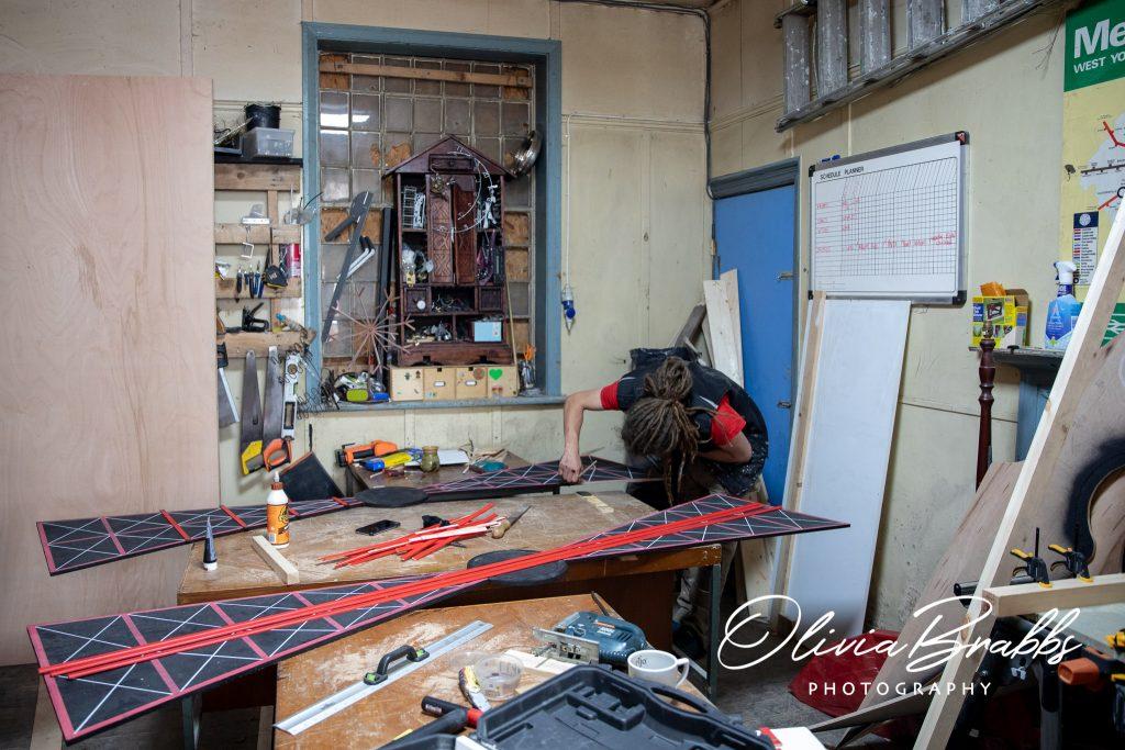 prop maker tom brader at work in water house studios