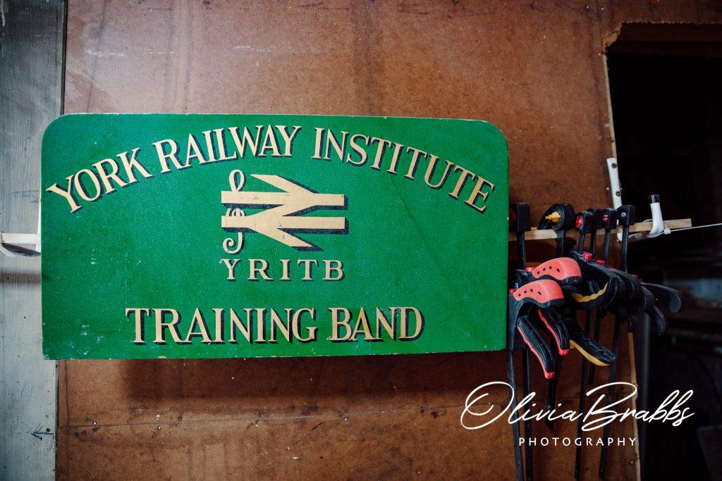 interior detail of artist studios at water house in york showing original railway institute sign