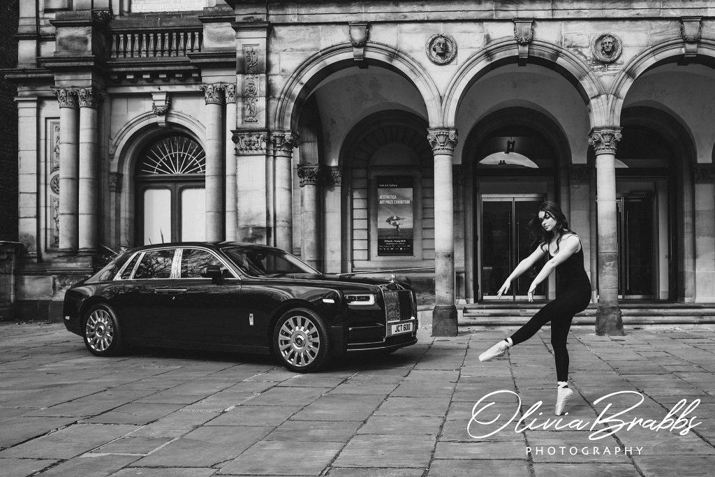 female model and ballerina dancing outside york art gallery with a rolls royce phantom