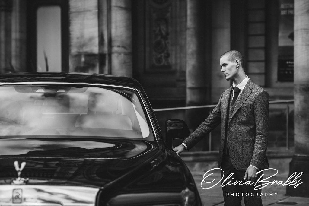 fashion shoot for york fashion week with rolls royce leeds with male model by phantom car wearing abraham moon suit