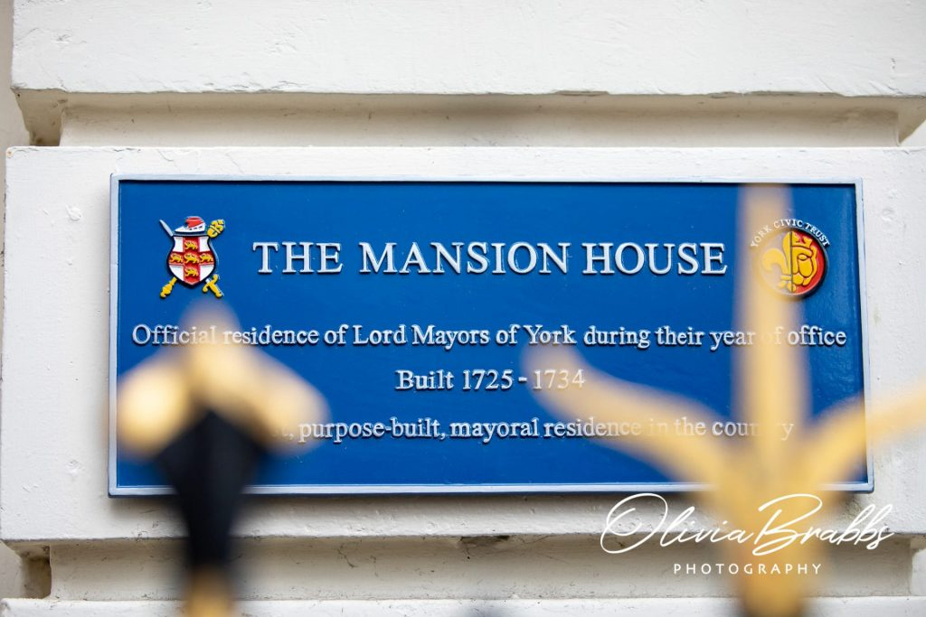 blue plaque on front of york mansion house
