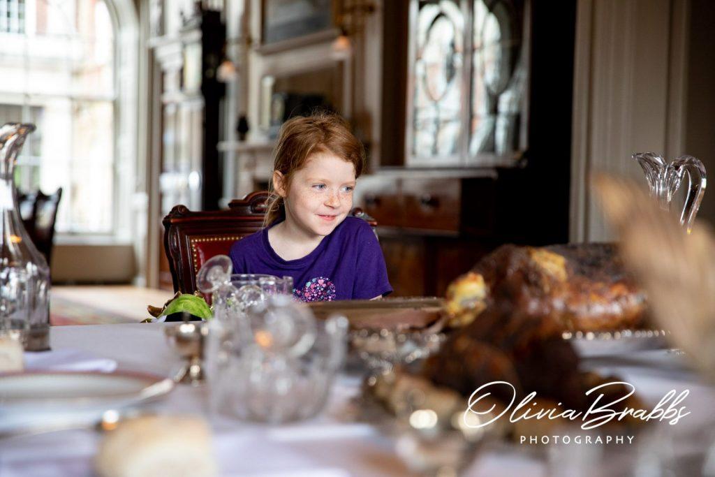 child enjoying georgian dining room display at york mansion house
