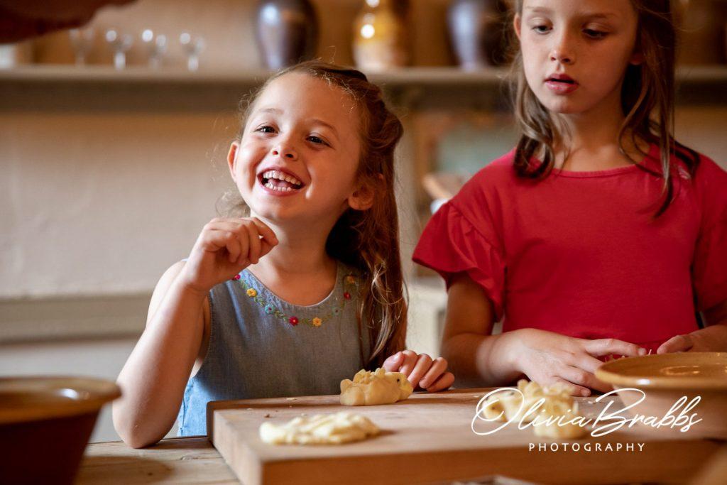 smiling child enjoying interactive georgian kitchen experience at york mansion house