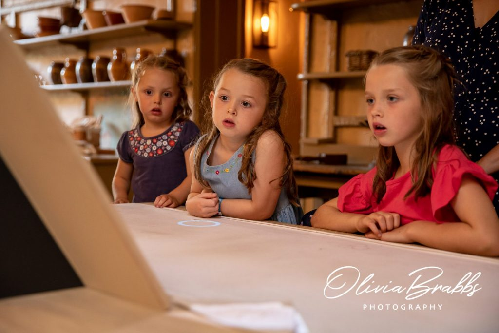 children watching interactive cooking display at york mansion house