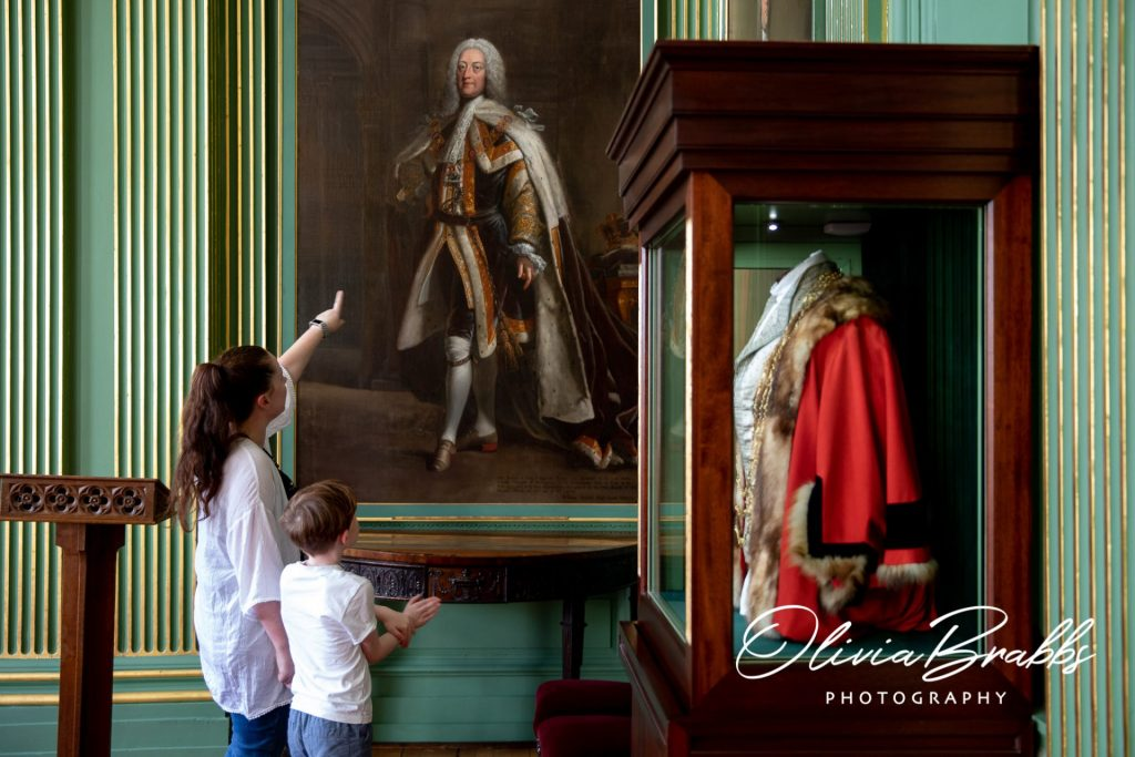 mother and son looking at oil painting at the york mansion house