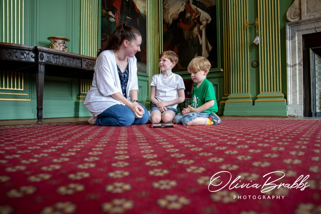 mother and two sons enjoying a visit to the state room at york mansion house