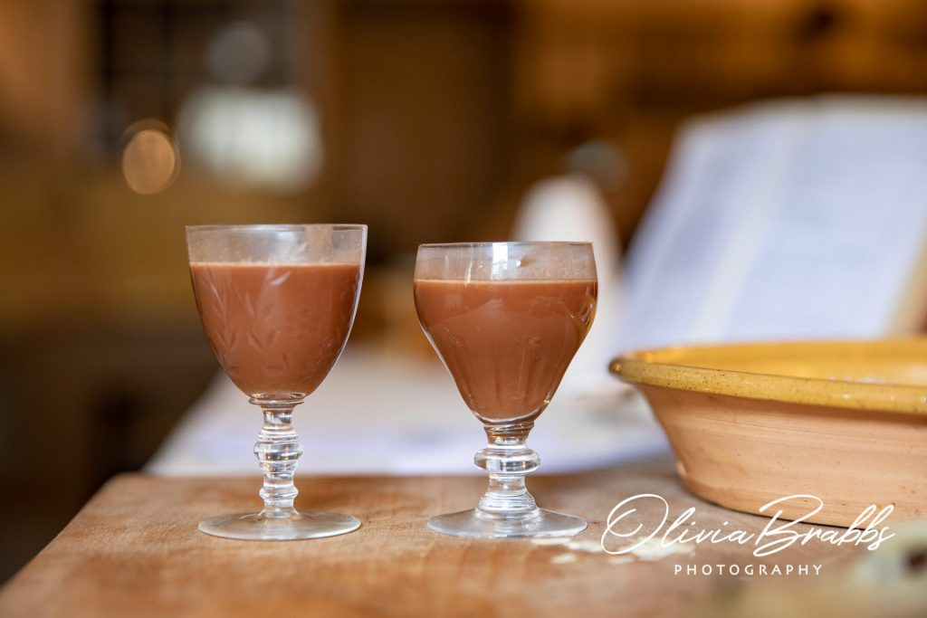 glasses of wine chocolate created in kitchen demonstration with original georgian recipe at york mansion house