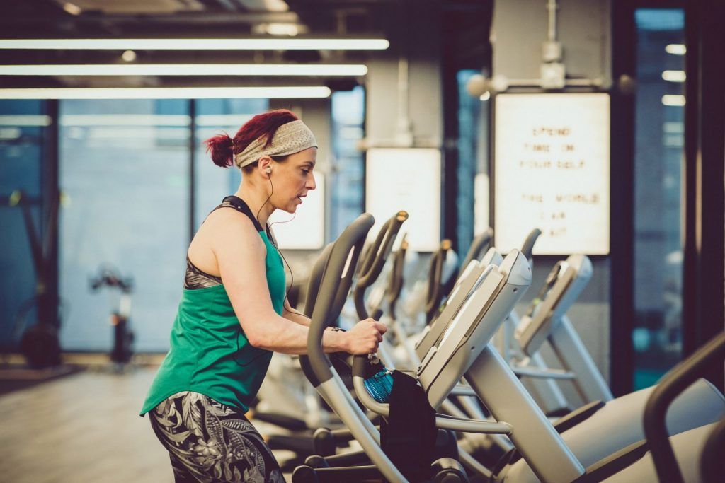 woman working out on cross fit machine at supersonic fitness in york